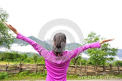 Cheering woman open arms in tibet