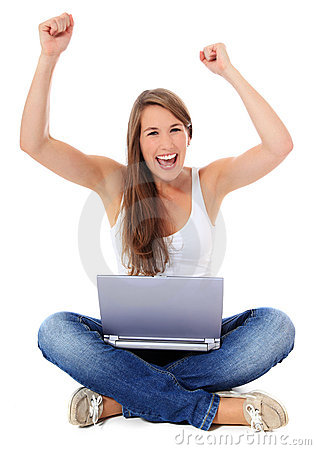 Cheering young woman with laptop