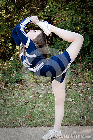 Cheerleader doing scorpion pose