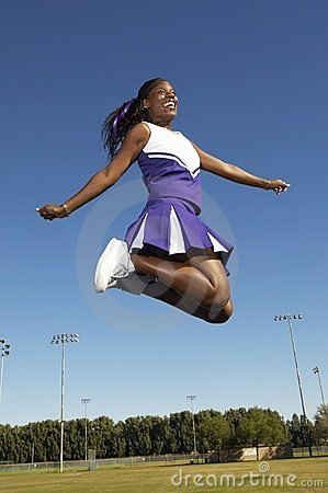 Cheerleader jumping on field