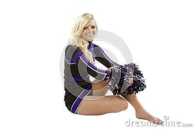 Cheerleader sitting sideways