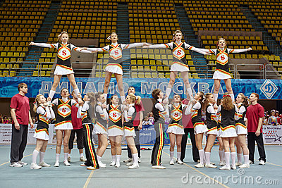 Cheerleaders team performs stunts at Championship Editorial Stock Image
