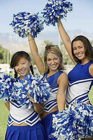 Cheerleaders waving pom-poms