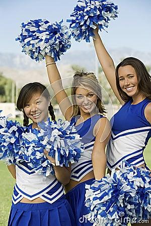 Cheerleaders waving pom-poms