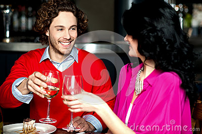 Cheers! Couple celebrating their love together