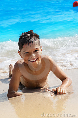 Free Cheery Boy On The Beach Royalty Free Stock Photos - 6112638