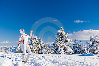 Cheery skier on the top of mountain