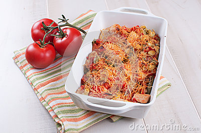 Cheese bakes vegetables and poultry casserole