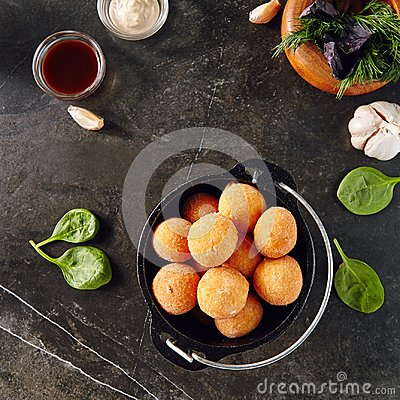 Free Cheese Balls In Metal Bowler On Dark Background Royalty Free Stock Images - 120521899