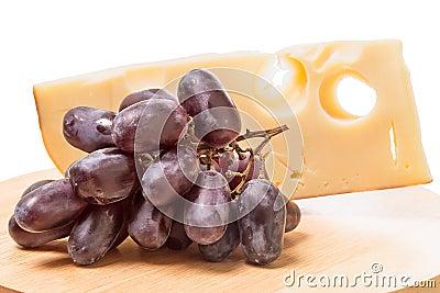 Cheese and dark grapes