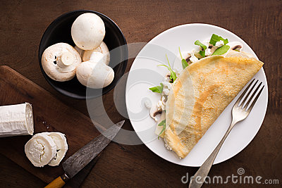 Cheese and mushrooms crepe with salad