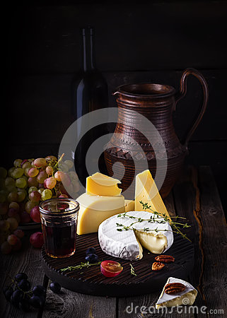 Free Cheese Plate,grape And Wine. Still Life In Rustic Style. Royalty Free Stock Photography - 63013427