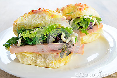 Cheese rolls with ham and salad