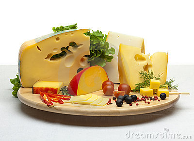 Cheese still life on a wooden round