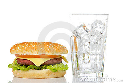 Cheeseburger and empty glass