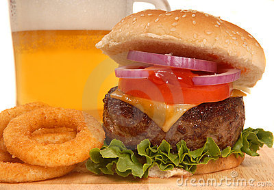 Cheeseburger with onion rings and beer