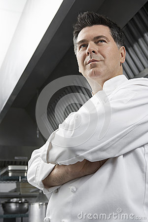 Chef With Arms Crossed In Kitchen