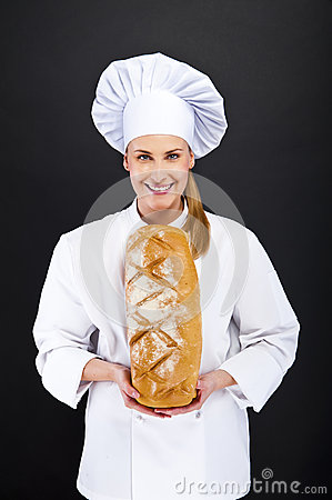 Chef baker smailing and holding fresh bread