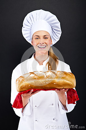 Chef baker smelling baked bread.