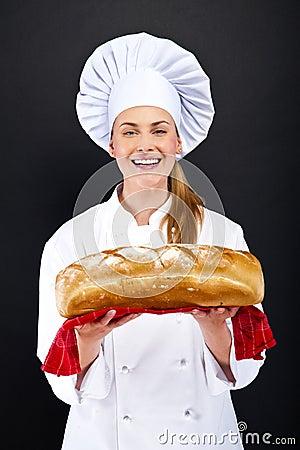 Chef baker smelling baked bread.