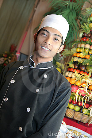 Chef in buffet smiling