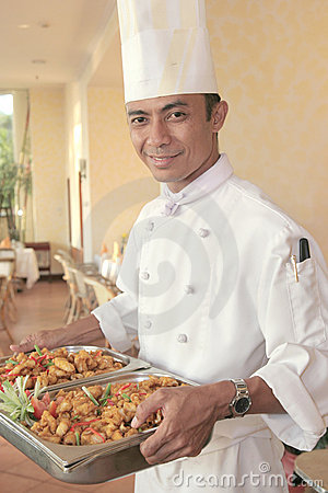 Chef carrying food for buffet