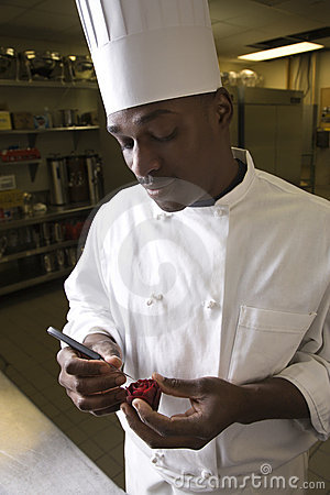 Chef carving beet.