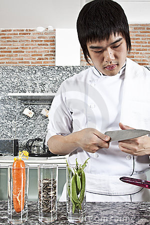 Chef checking a knife.