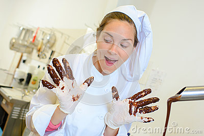 Chef with chocolate on gloved hands Stock Photo