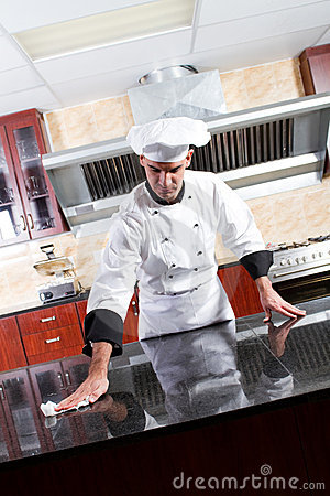 Free Chef Cleaning Kitchen Stock Image - 14985191