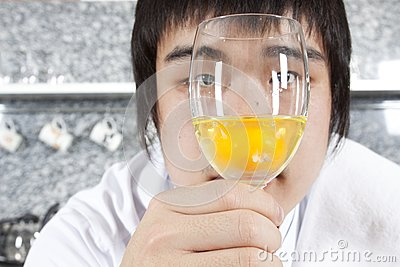 Chef considering a glass of raw egg