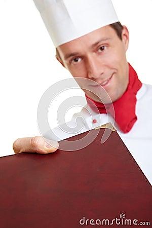 Chef cook bringing menu card