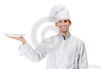 Chef cook handing a white plate