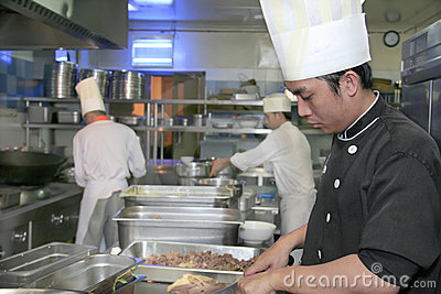 Chef cooking at kitchen