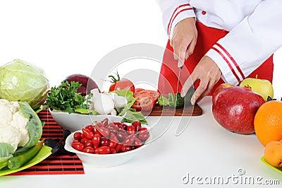 Chef cuts the cucumber