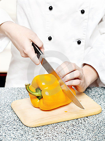 Chef cutting bell peppers