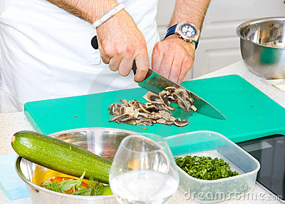 Chef cutting the mushrooms