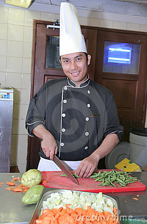 Chef cutting vegetable