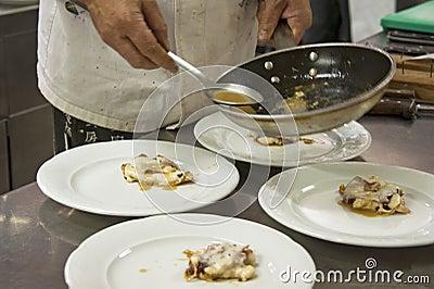 Chef decorating delicious dish