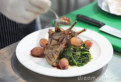 Chef is decorating grilled rack of lamb