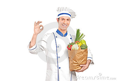 Chef gesturing delicious hand sign