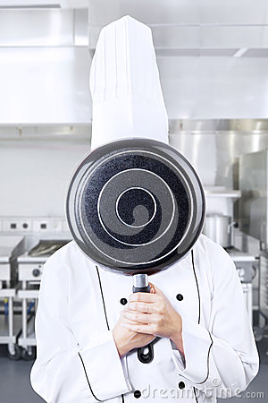 Chef behind pan at work