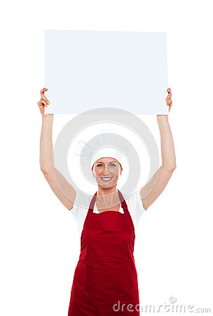 Chef holding advertising board over her head