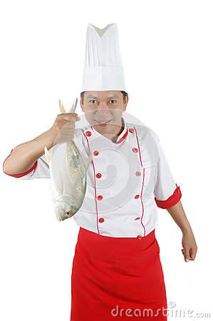 Chef holding a big raw fish