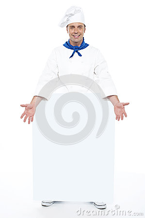 Chef holding blank billboard. Full length shot