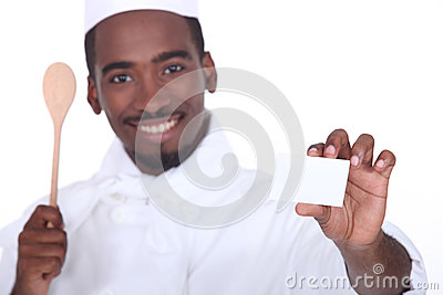 Chef holding business card