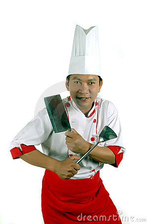 Chef holding cooking utensils and kitchen knife