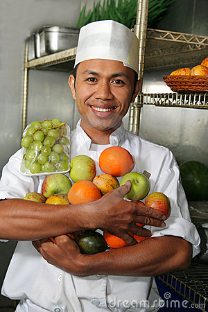 Chef holding fruits
