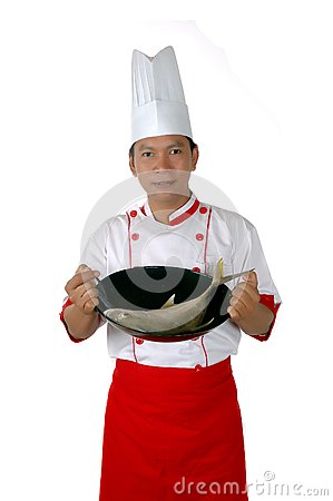 Chef holding raw fish on a frying pan