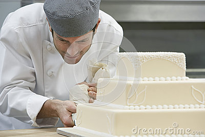Chef Icing Wedding Cake
